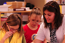 Student teacher working with two students