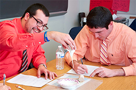 Students learning a science experiment in class