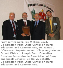 award_2005_winners  - group of people with award plaque