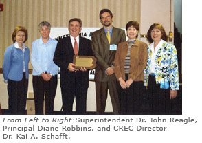 group with the award plaque