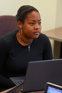 Female student listening with computer