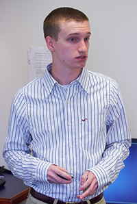 Male student giving presentation