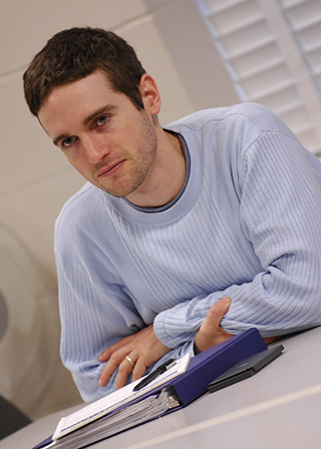male Student listening in class