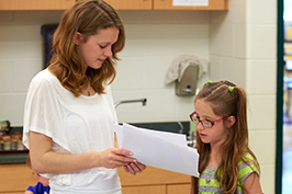 Student teacher working with a student