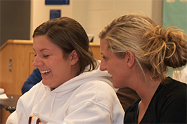 Two female students laughing
