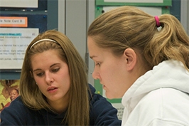 Two female students working together in class