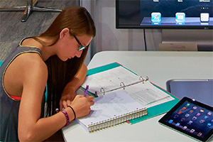 Student studying with tablet