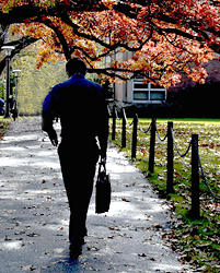 Man walking on campus with briefcase