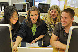 Students huddled around a computer in Gail Boldt's spring 2010 class