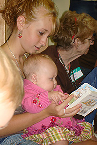 mother and baby read a book