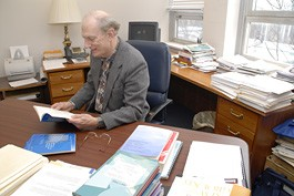 Fred Volkwein reviews research at his desk