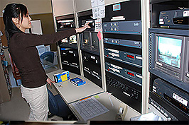 woman stands in computer room