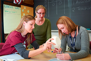 Three students work on a science education project