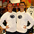 Shannon (L) and Kelly Lechner pose wearing Penn State gear