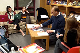 Students seated with laptops and instructor teaching from a seated position  in CI 495 F Math Manipulation workshop